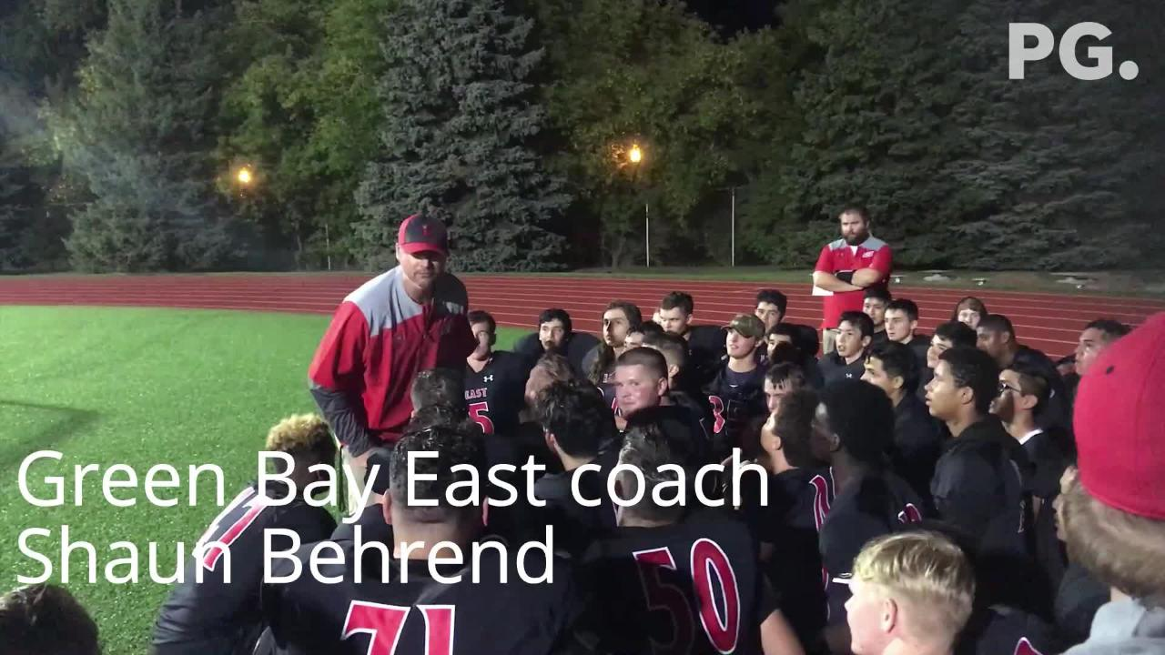 Green Bay East football coach Shaun Behrend speaks to his team after a 34-20 win over Shawano on Aug. 31, 2018.