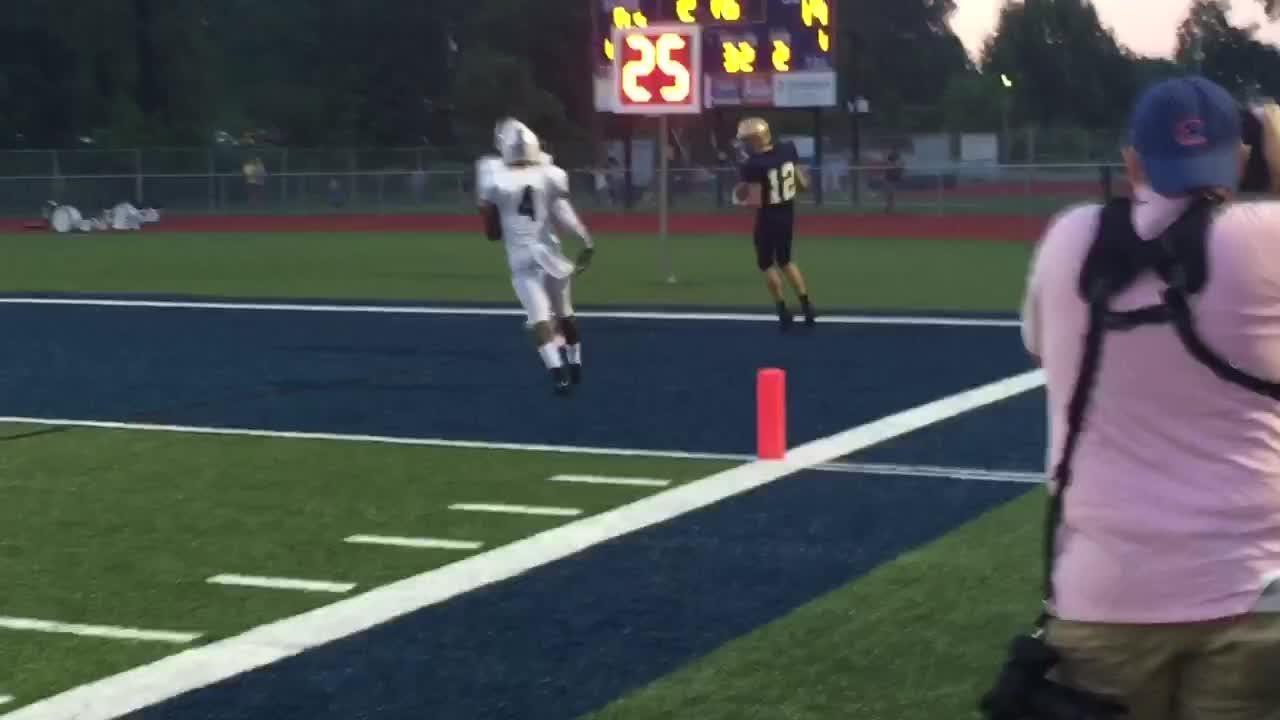 Lancaster junior Casey Finck scores on a 32-yard touchdown pass from Tyler Monk.