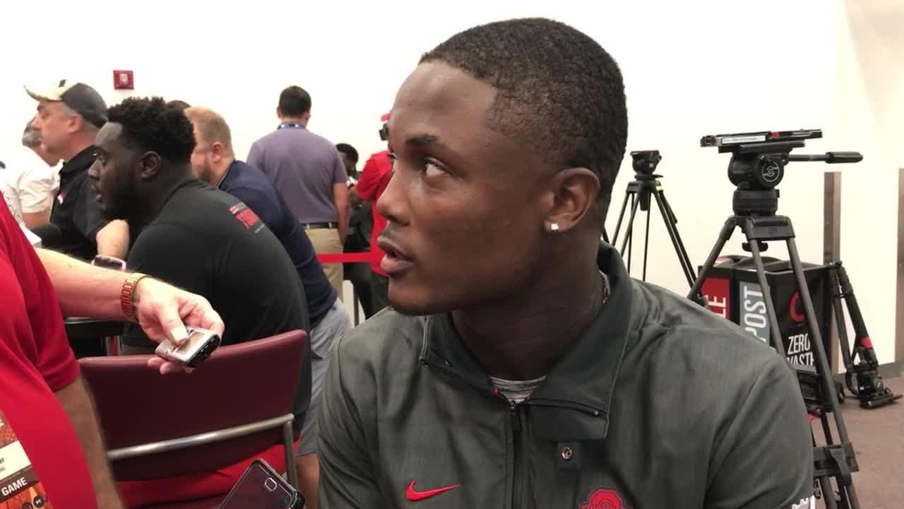OSU captain Terry McLaurin caught two TD passes, including a 75-yarder, in 77-31 rout of Oregon State