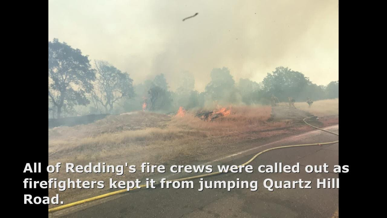 The Quartz Hill Road fire in Redding on Sunday burned more than 10 acres of grass, brush and trees.