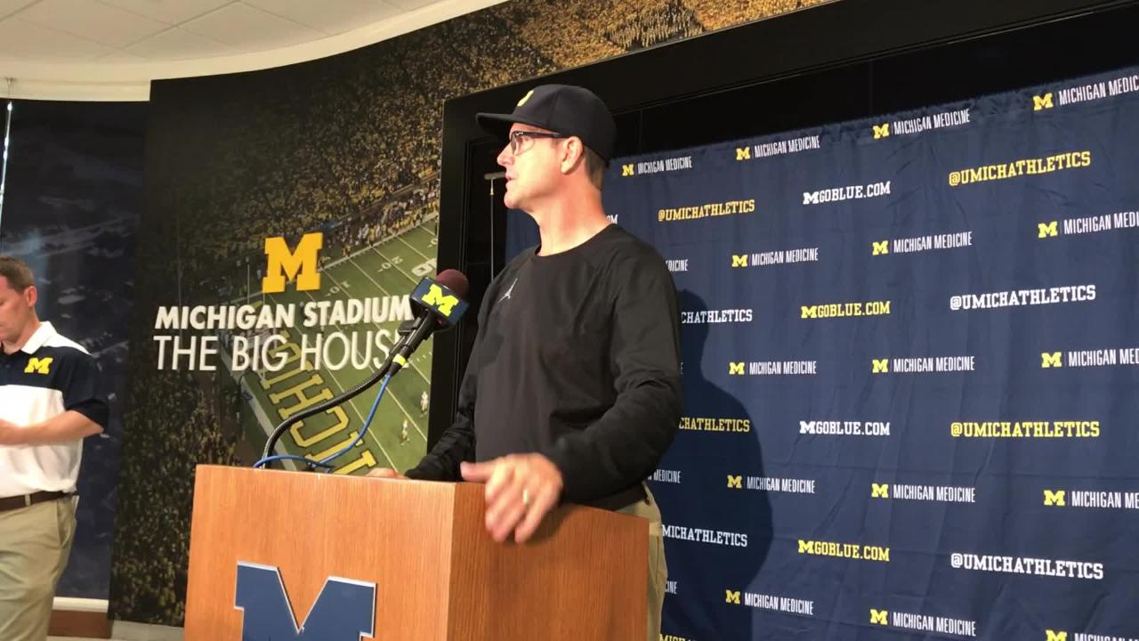 Michigan football coach Jim Harbaugh tells reporters that the play of the offensive line has improved.