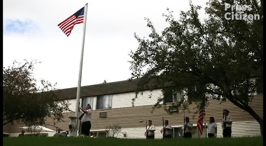 World War II U.S. Navy veteran Russell H. Ware raises new flag with members of Iowa City and Coralville American Legions