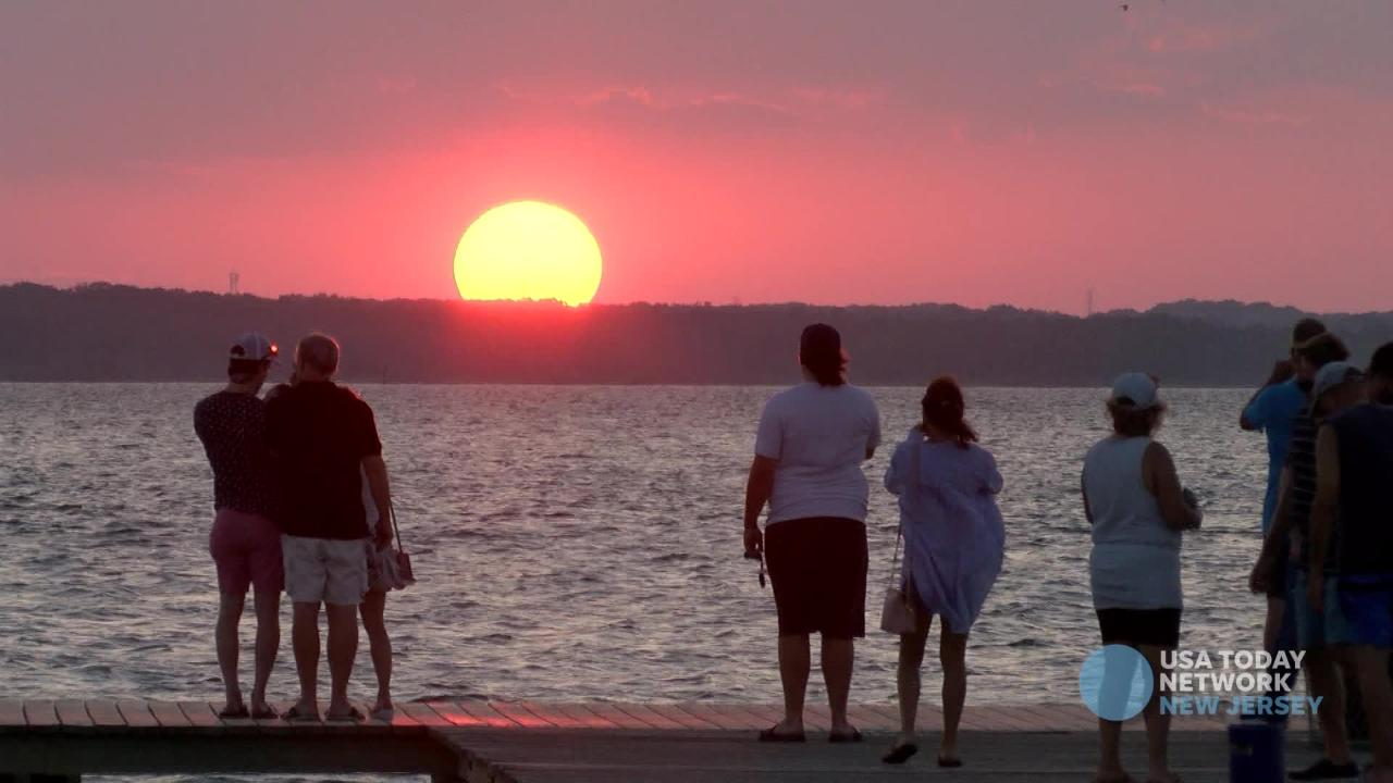 People gather on the Lavallette fishing pier in the Barnegat Bay to take in the final sunset of the summer.