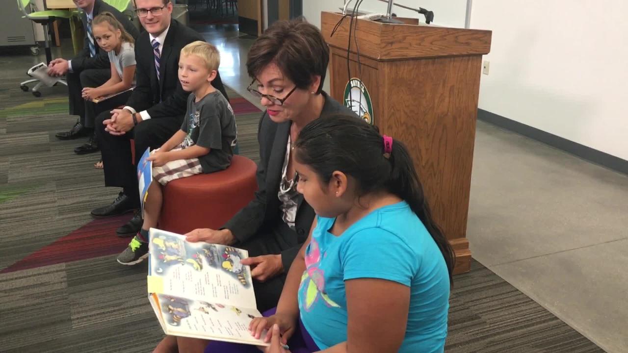 Iowa Gov. Kim Reynolds reads at Cornell Elementary School with third grader Guadalupe Sanchez, age 8.