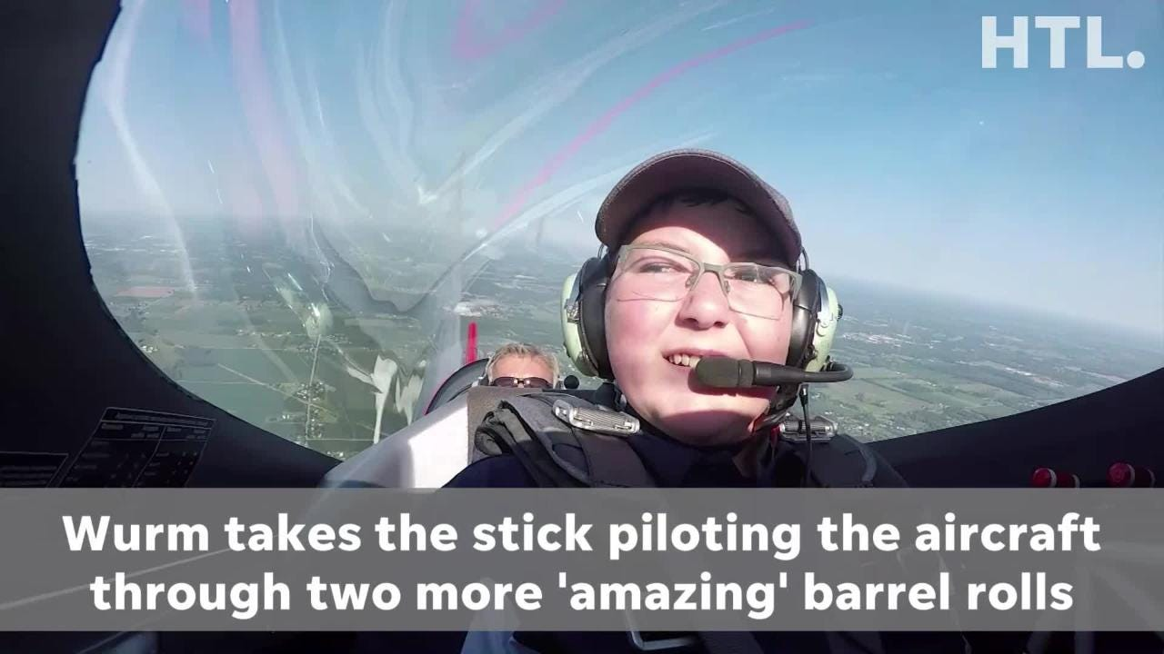 With stunt pilot Sean Tucker, 13-year-old Westland resident Buster Wurm, guides the aircraft through two barrel rolls.