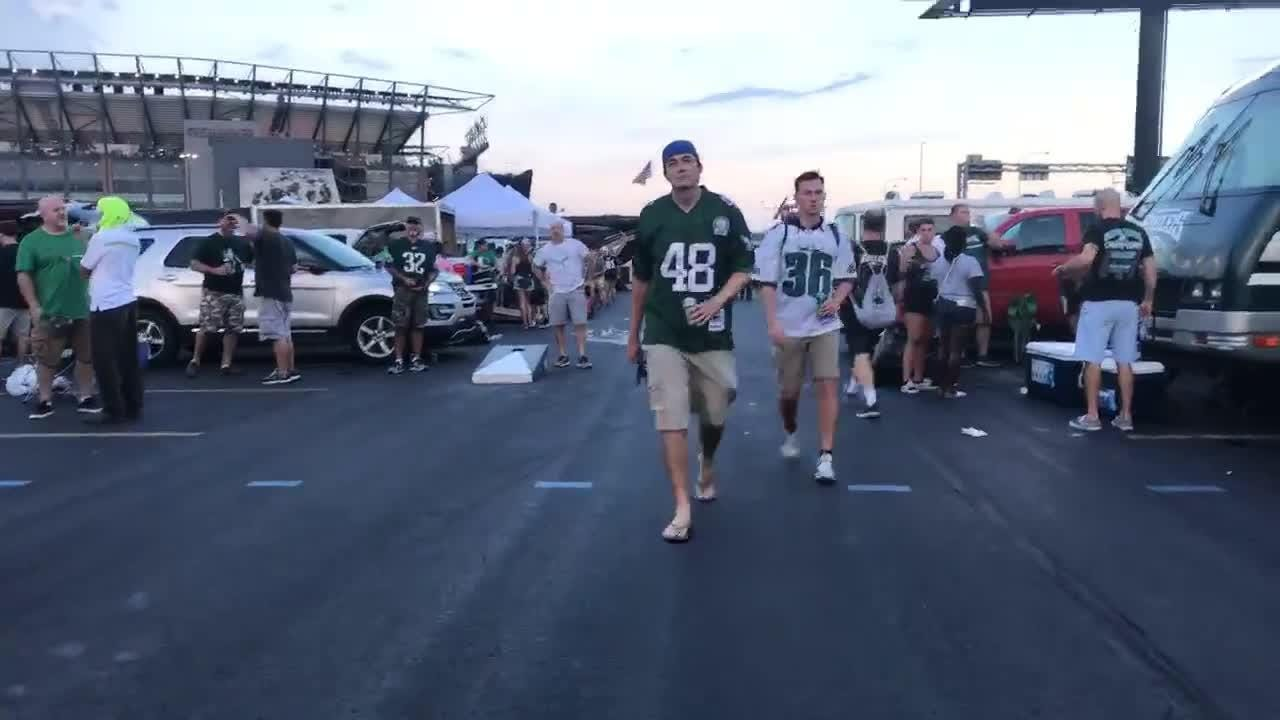 Kevin Tresolini hangs out with tailgaters at Lincoln Financial Field before the home opener.