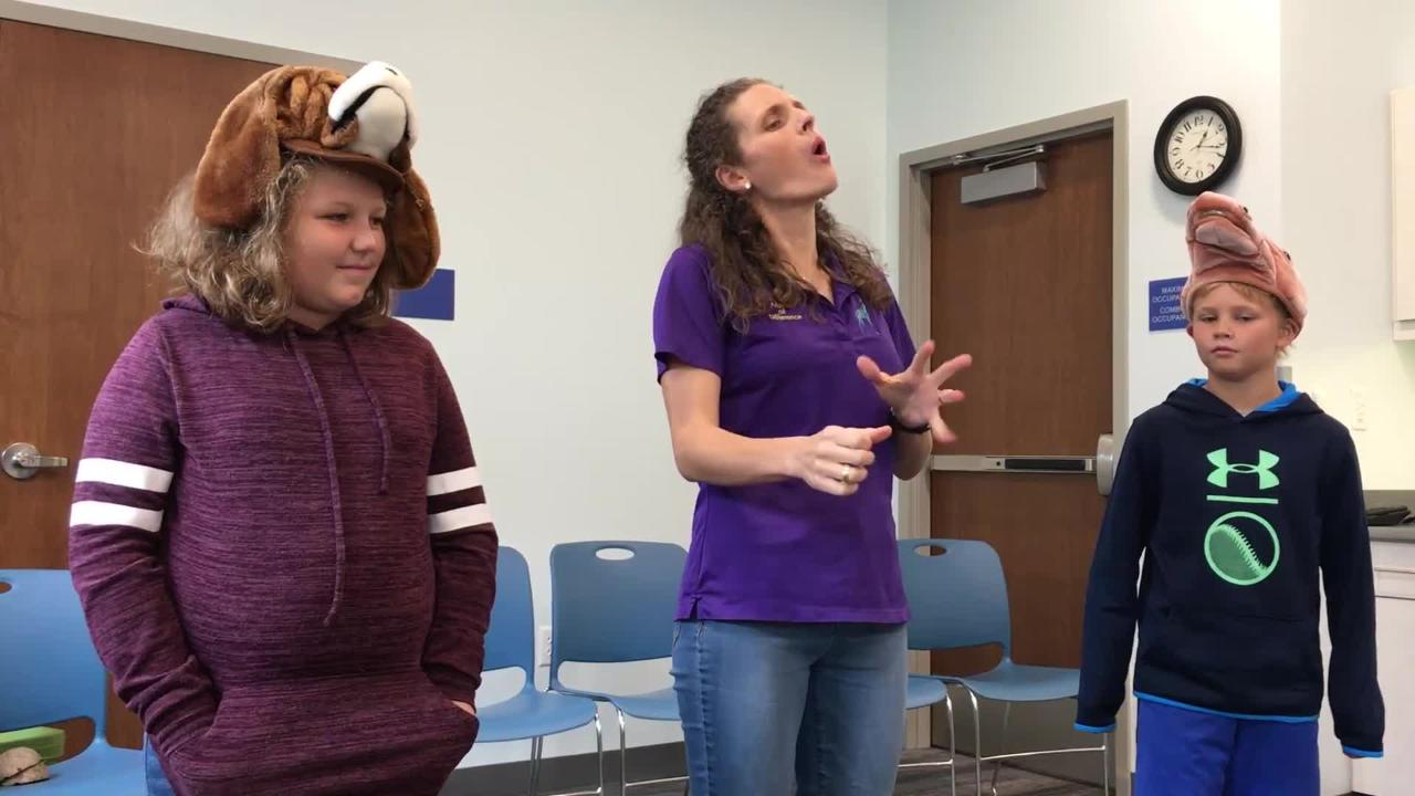 "Interactive storyteller Lindsay Bonilla tells the fairytale ""The Bremen Town Musicians"" with audience help at Marblehead Peninsula Branch Library."