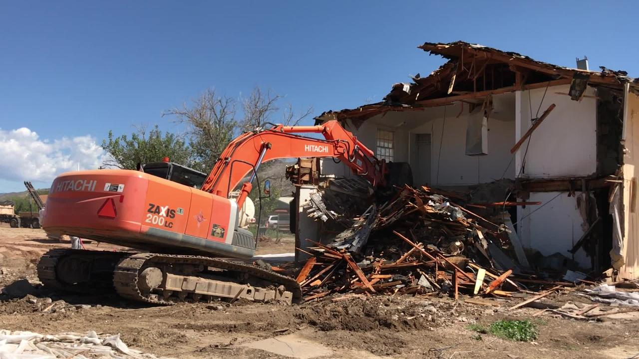 Building number 2 of the Sahara Apartment complex is steadily dismantled by an excavator on Sept. 10