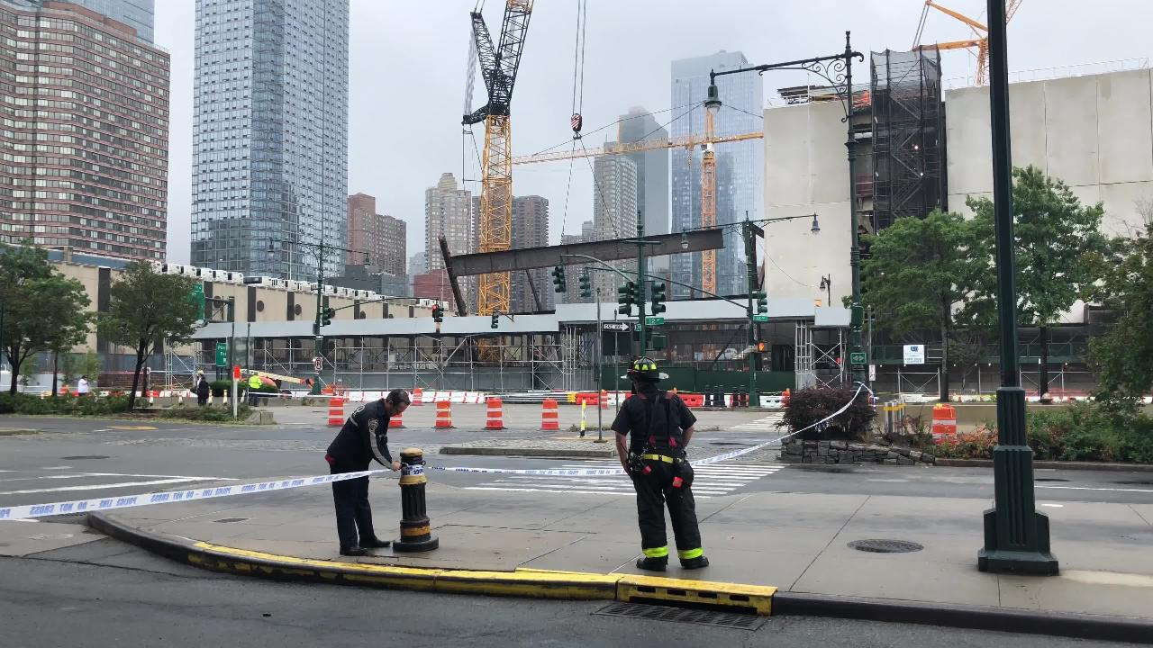 A crane carrying a steel beam collapsed at a construction site on 39th street in NYC shutting down 12th avenue in both direction and the midtown ferry station.