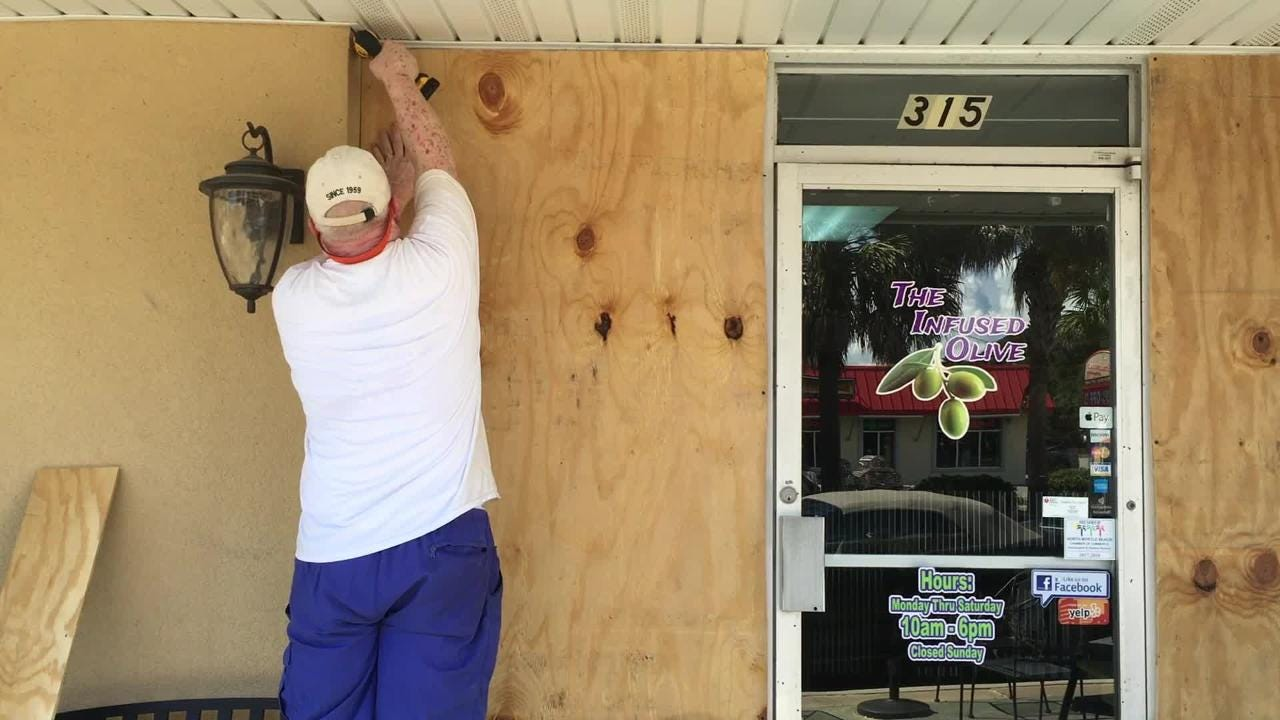 Lee Dorton boarding up his business in North Myrtle, South Carolina, in anticipation of Hurricane Florence on Tuesday, Sept. 11, 2018.