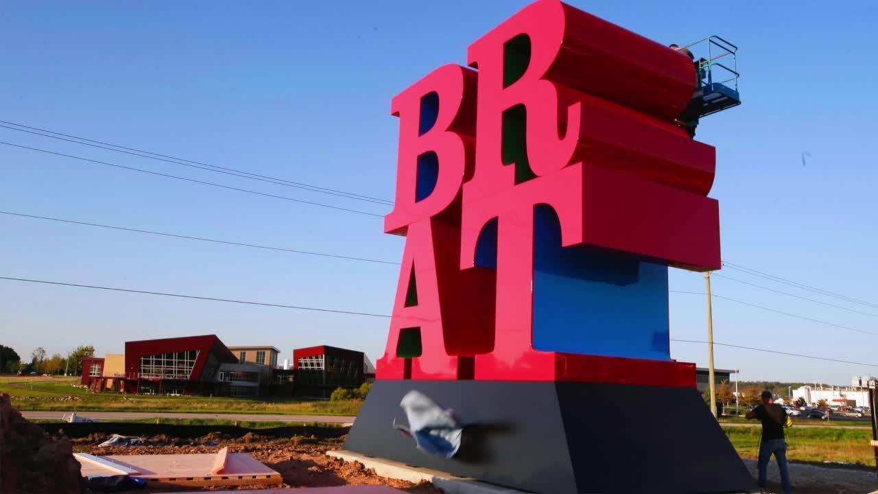 Johnsonville Foods unveils new store plans next to BRAT sculpture
