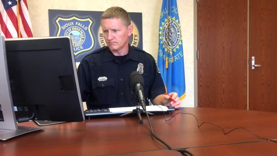Police spokesman Sam Clemens goes over the call log during Wednesday's briefing.