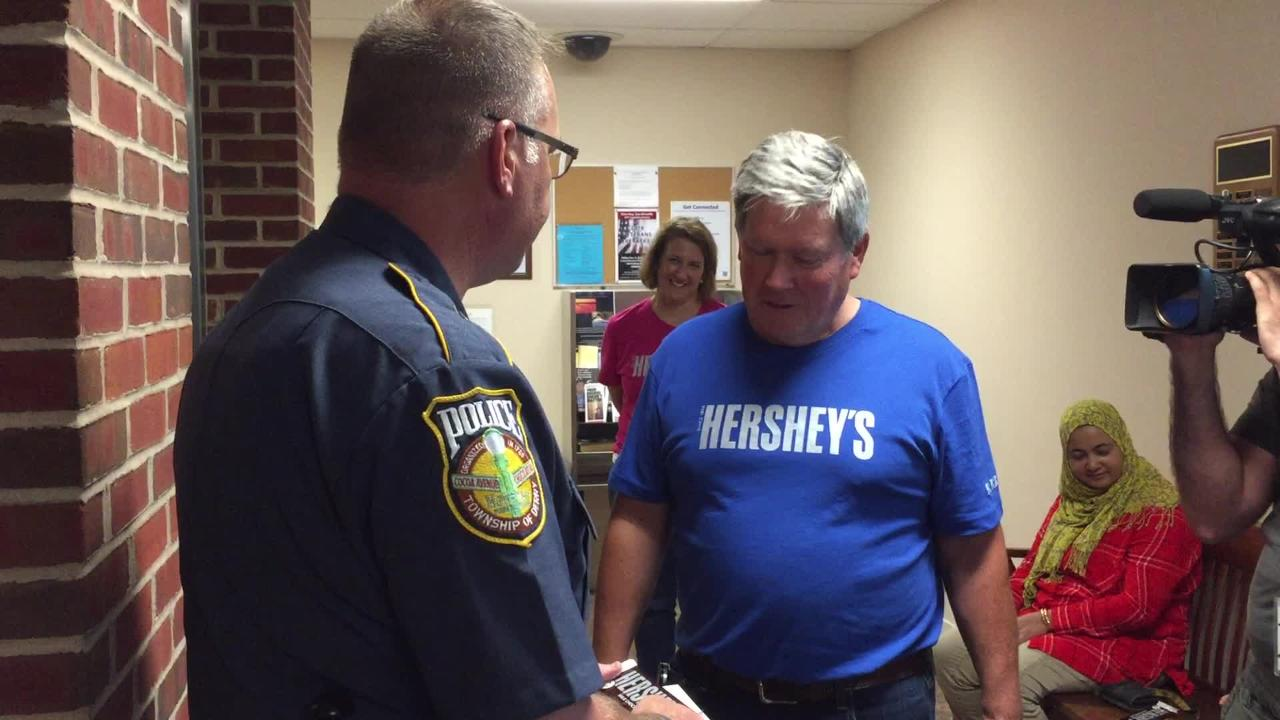 Watch Hershey's employees visit the Derry Township police and thank officers with chocolate bars