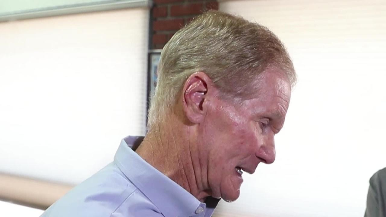 U.S. Sen. Bill Nelson listens to business owners affected by red tide and algae issues