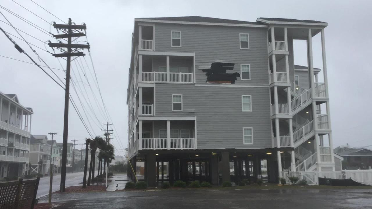Strong winds rip through North Myrtle Beach and tear at the siding of a building Friday, Sept. 14, 2018, following Hurricane Florence's landfall.
