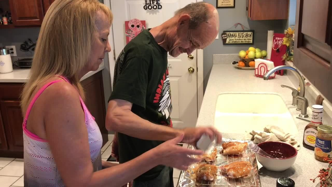 Deana Cushman helps David Hahn to make sweet and sour chicken, she's work with him for five years as a direct support professional.
