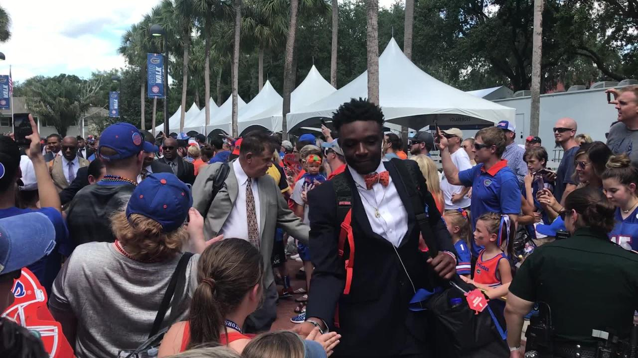 The Florida Gators football team enters the stadium before playing the Colorado State football team.