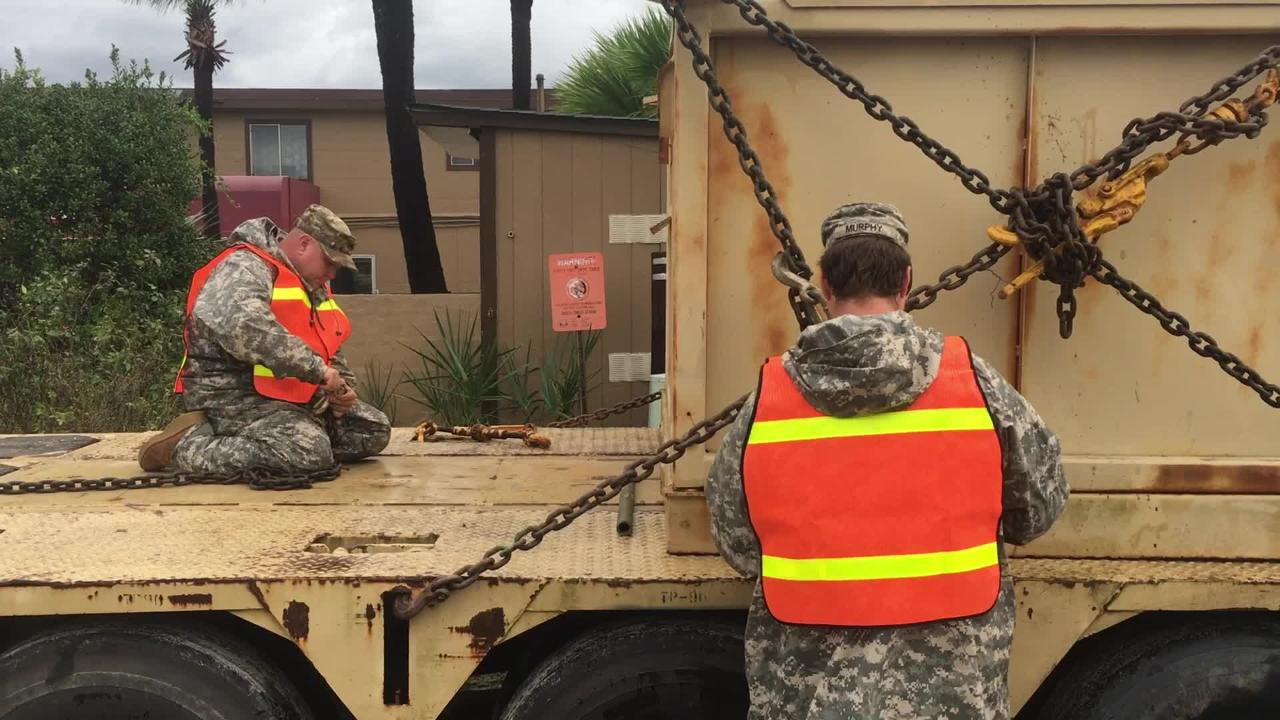 South Carolina National Guard load up trucks with sand near Conway as they head to the Waccamaw River on Sunday, Sept. 16, 2018.