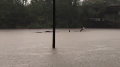 The Cape Fear River spills over its banks in Fayetteville, N.C., on Sept. 16, 2018.