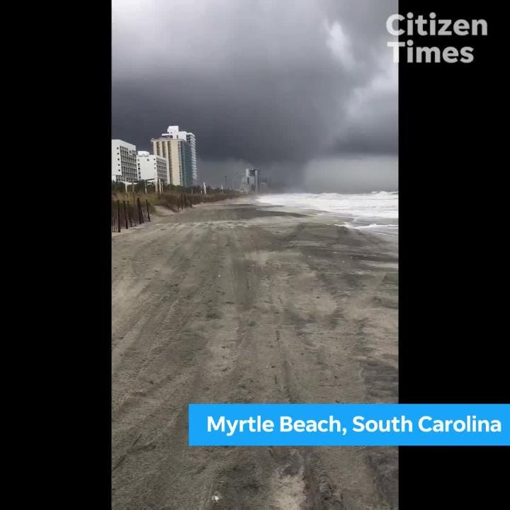 Allan Scott captured this video of a waterspot making landfall as a tornado and crashing into a building.
