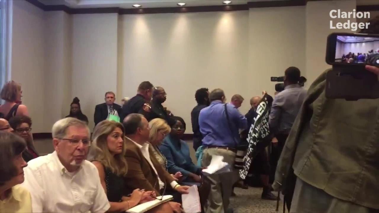 Protesters interrupt the Monday, Sept. 17, 2018, legislative budget hearings for the Mississippi Department of Corrections.