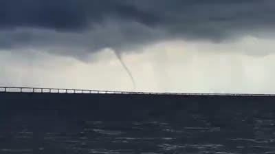 This was one of several dozen waterspouts that peeked out of the skies on Island Charters on Monday.