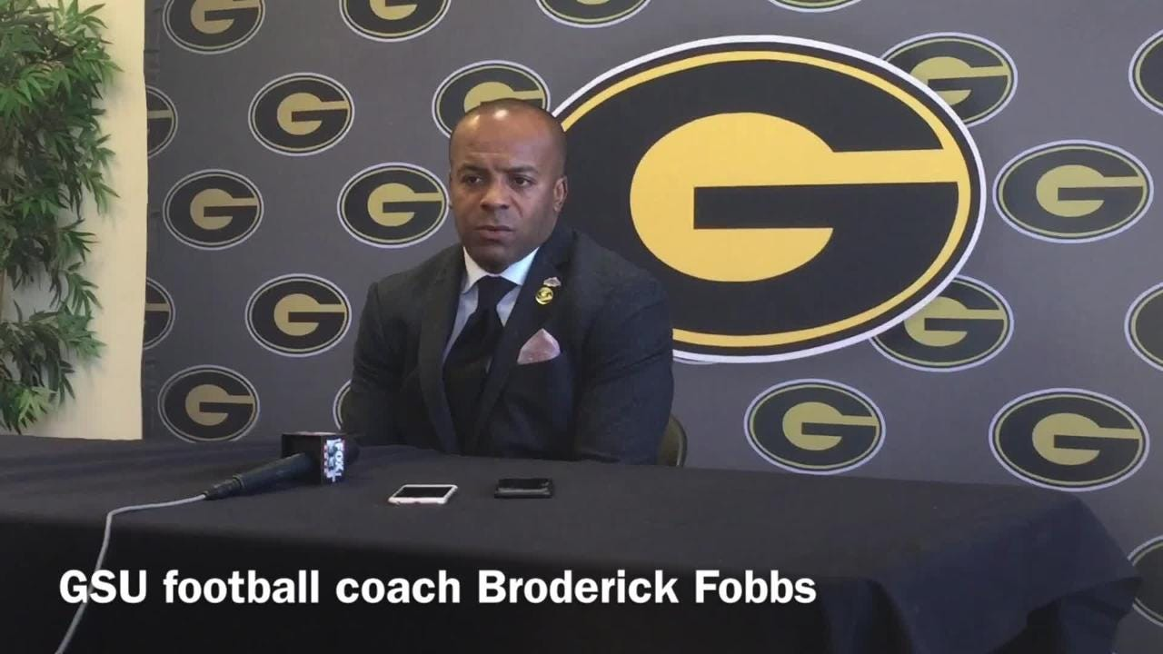 Grambling State head football coach Broderick Fobbs talks situation with running backs Jordan Jones, DeSherrius Flowers.