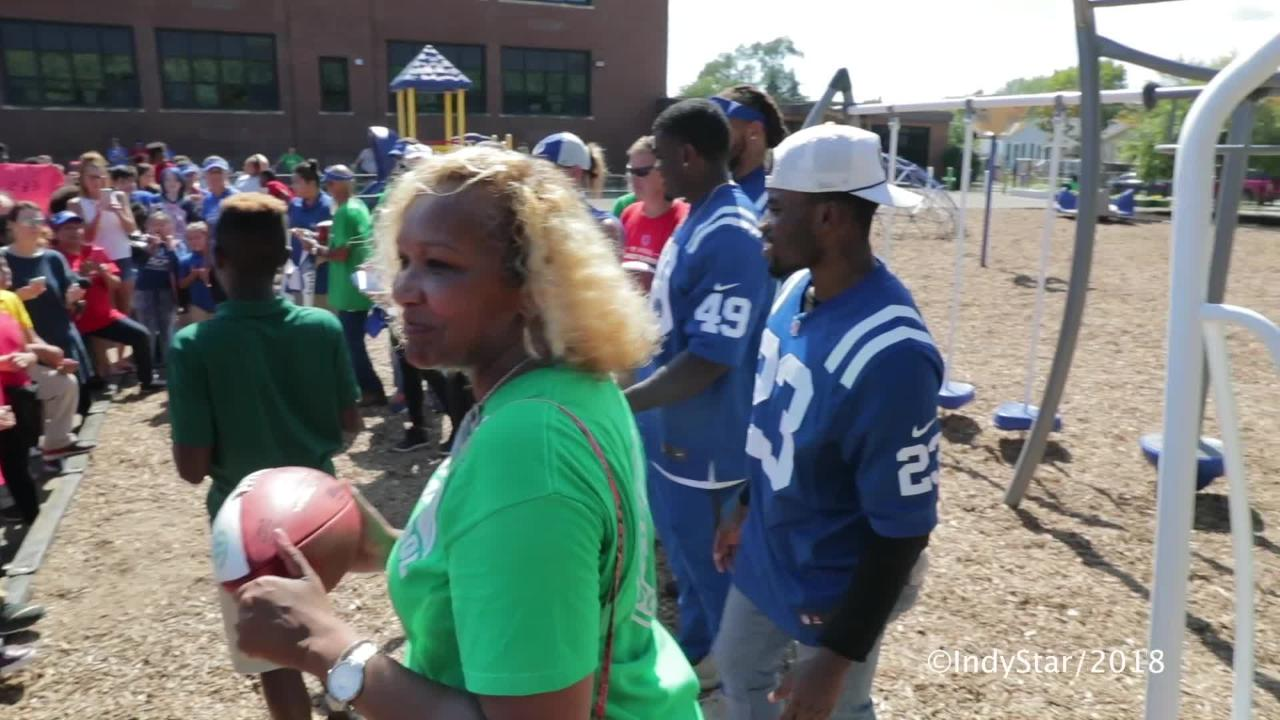Kids cheer during a ribbon cutting at IPS 67, after volunteers, including several Colts players, pitch in to build a playground, Mon., Sept 17, 2018.
