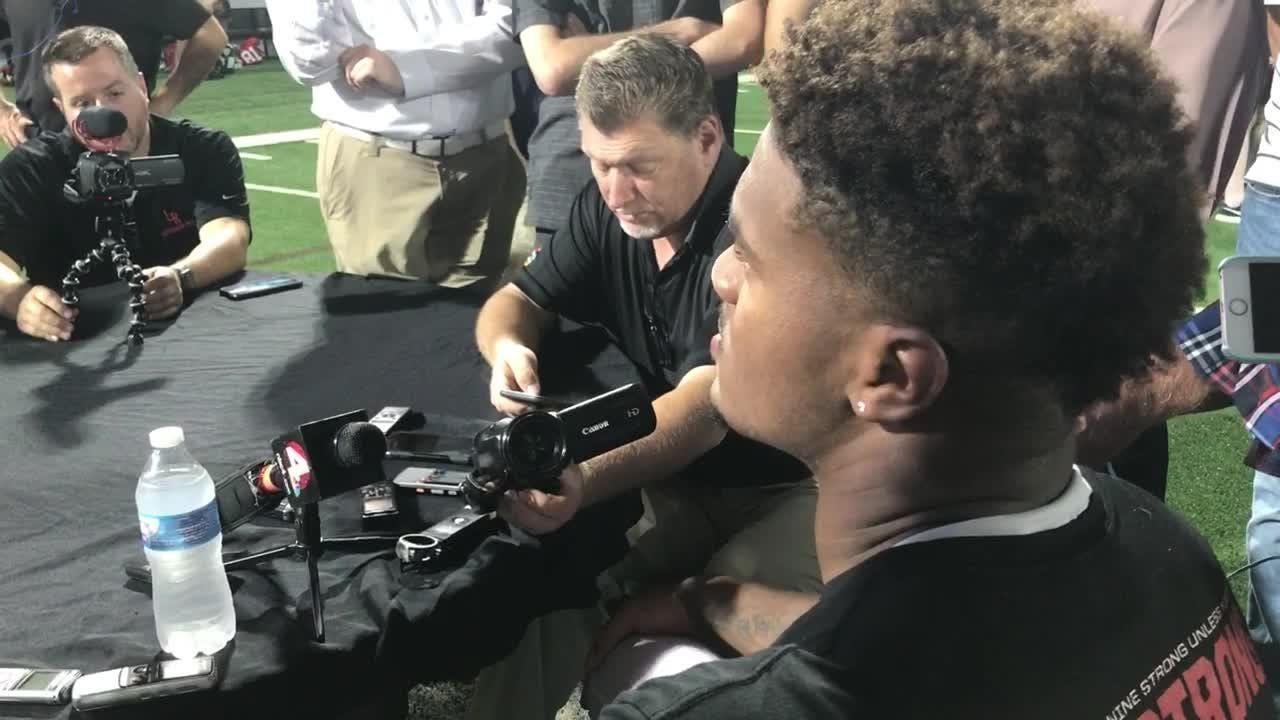 Urban Meyer talks to team