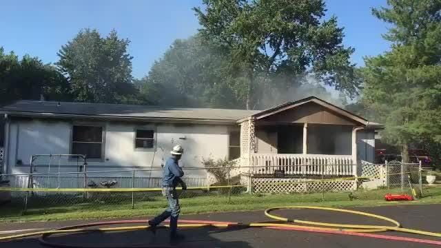 Firefighters work to put out a fire Wednesday, Sept. 19, 2018 at the Briarwood Mobile Home Park near Republic.
