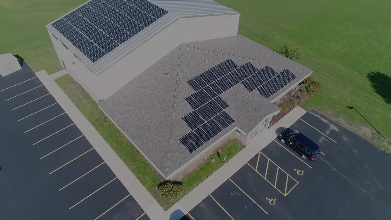 Drone footage of solar panel installations on Oneida Nation buildings. The project should save $80,000/year and cut 700 metric tons of carbon dioxide.