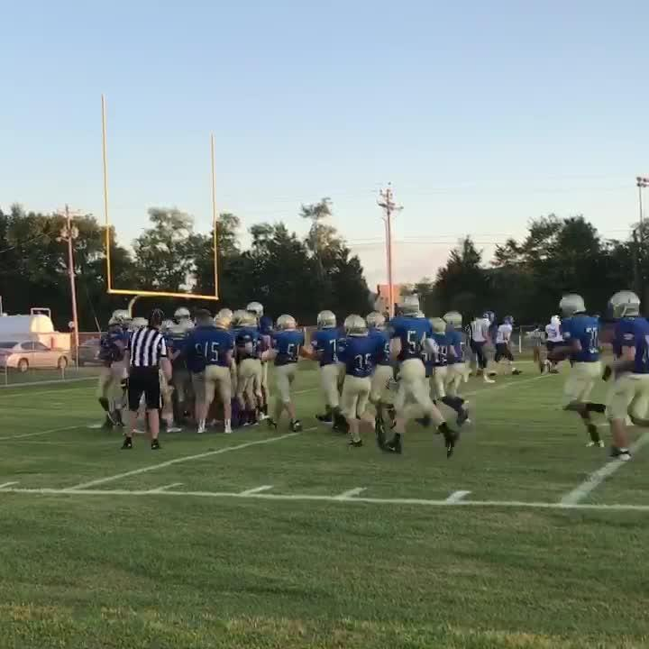 Aiden Atkins, a student with muscular dystrophy, fulfills dream by getting on field and end zone