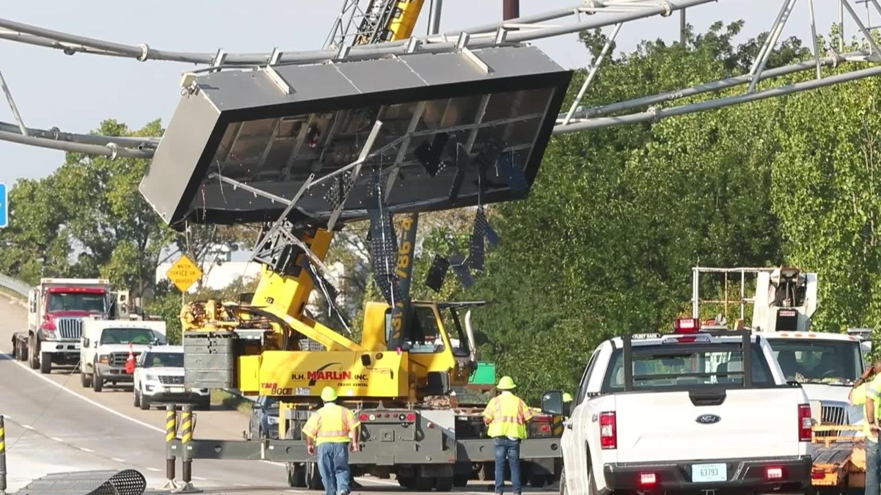 After a dump truck hit a message board sign on I-70 westbound, west of Emerson, morning rush-hour traffic was snarled.
