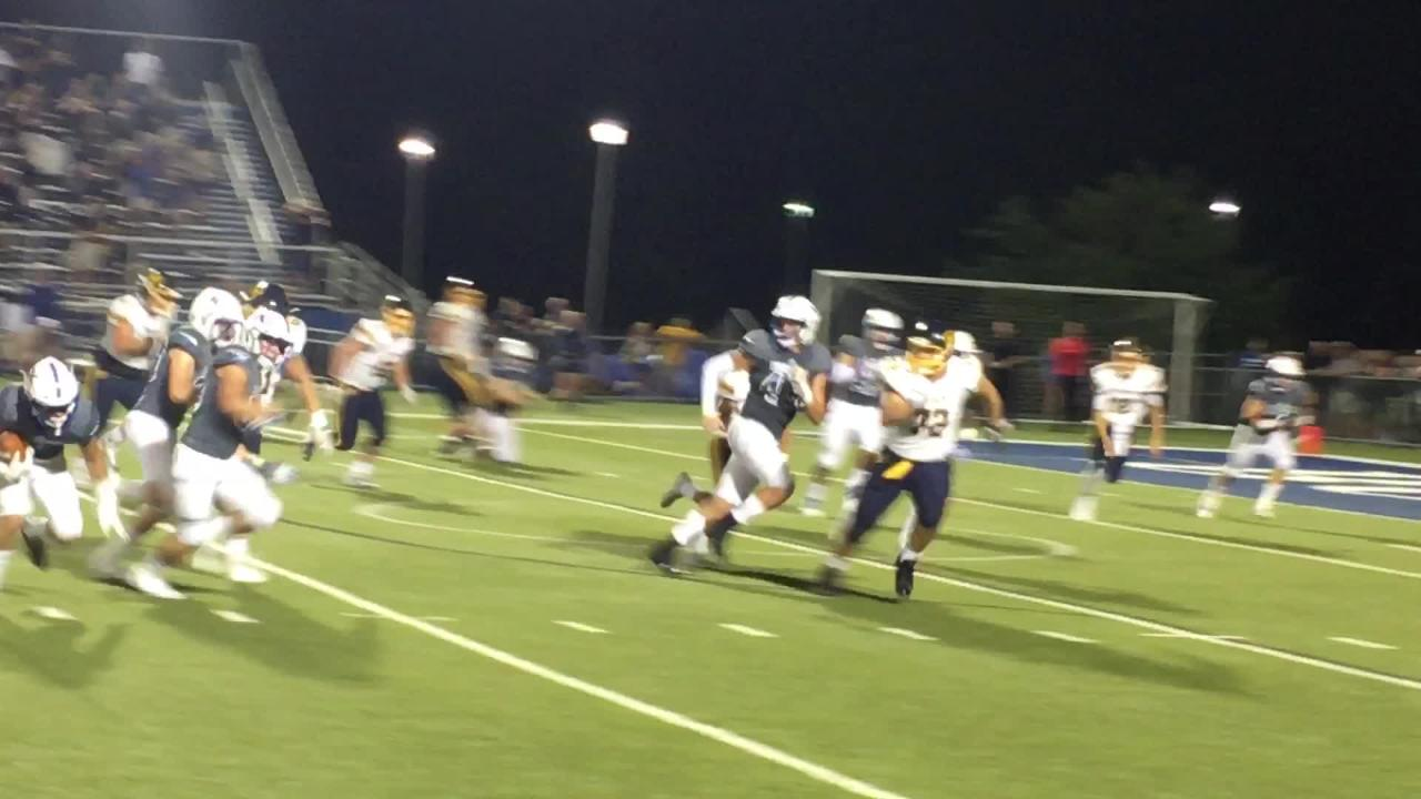 St. Xavier's Tucker Hundley with an INT