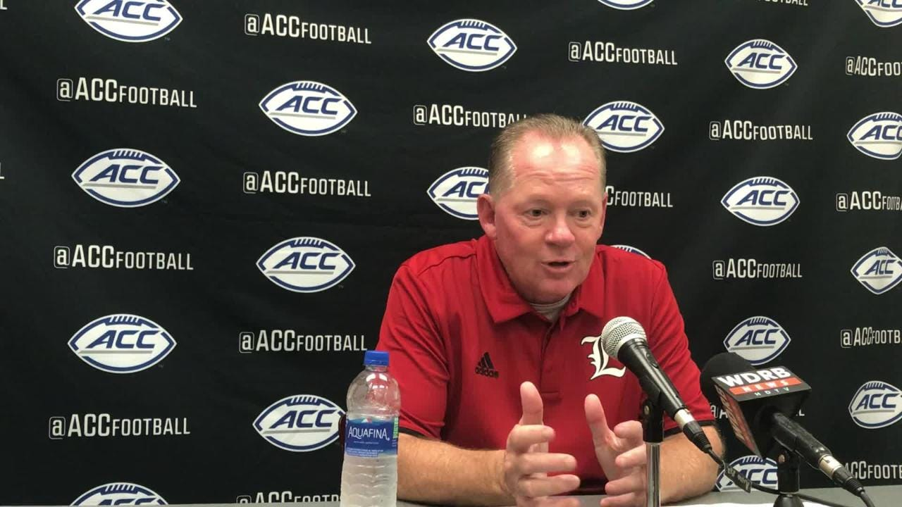Louisville coach Bobby Petrino addresses media after his team's 27-3 loss to Virginia on Saturday.