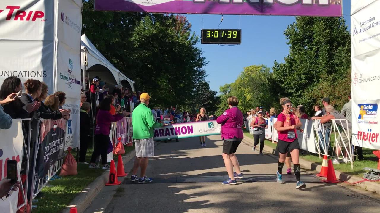 Kathy Derks finishes first for women in the Community First Fox Cities Marathon.