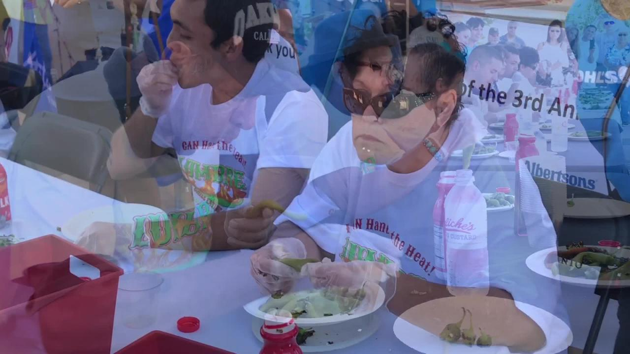 Contestants participate in the Lumbre Chile Eating Contest as part of La Gran Fiesta on Sunday, Sept. 23, 2018 on the Plaza de Las Cruces