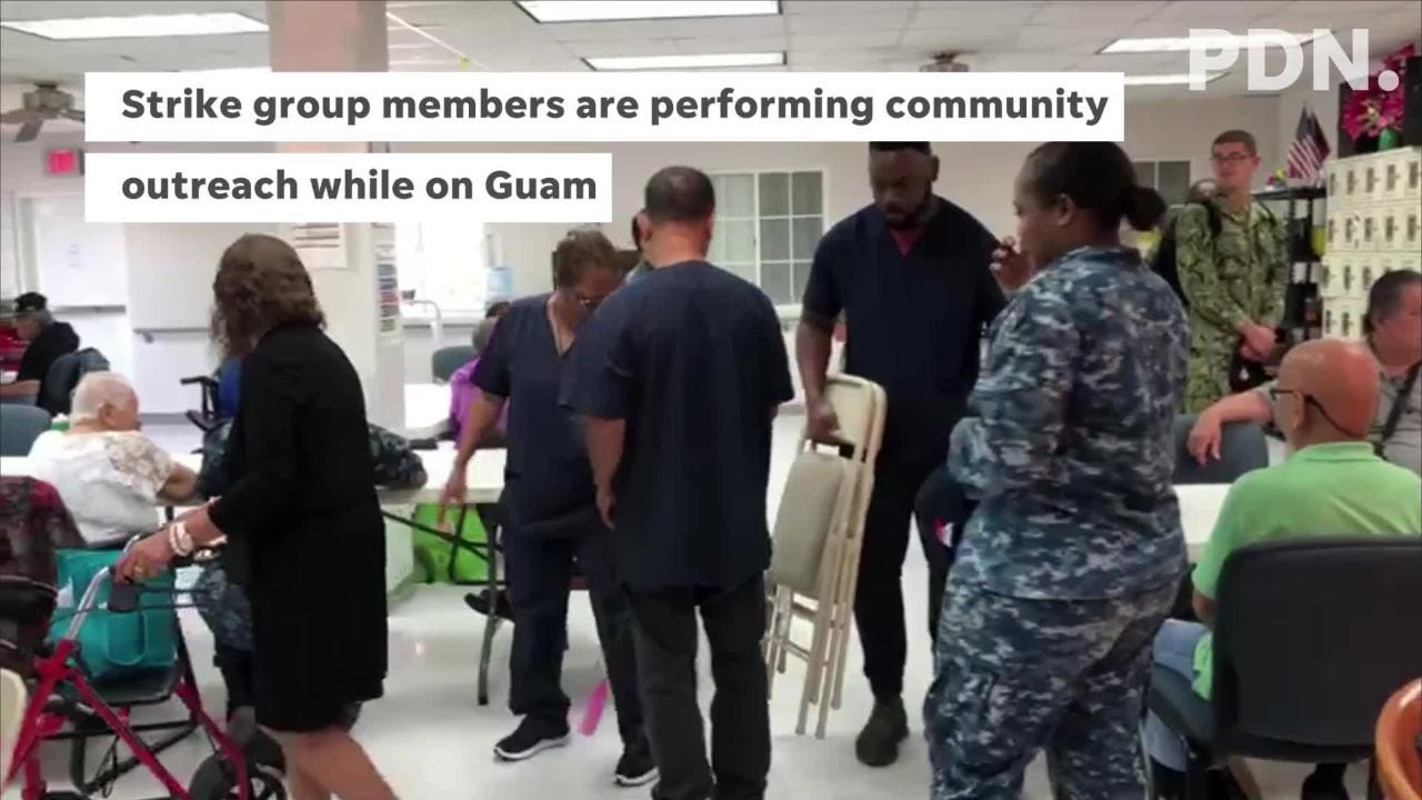 Service members perform community outreach