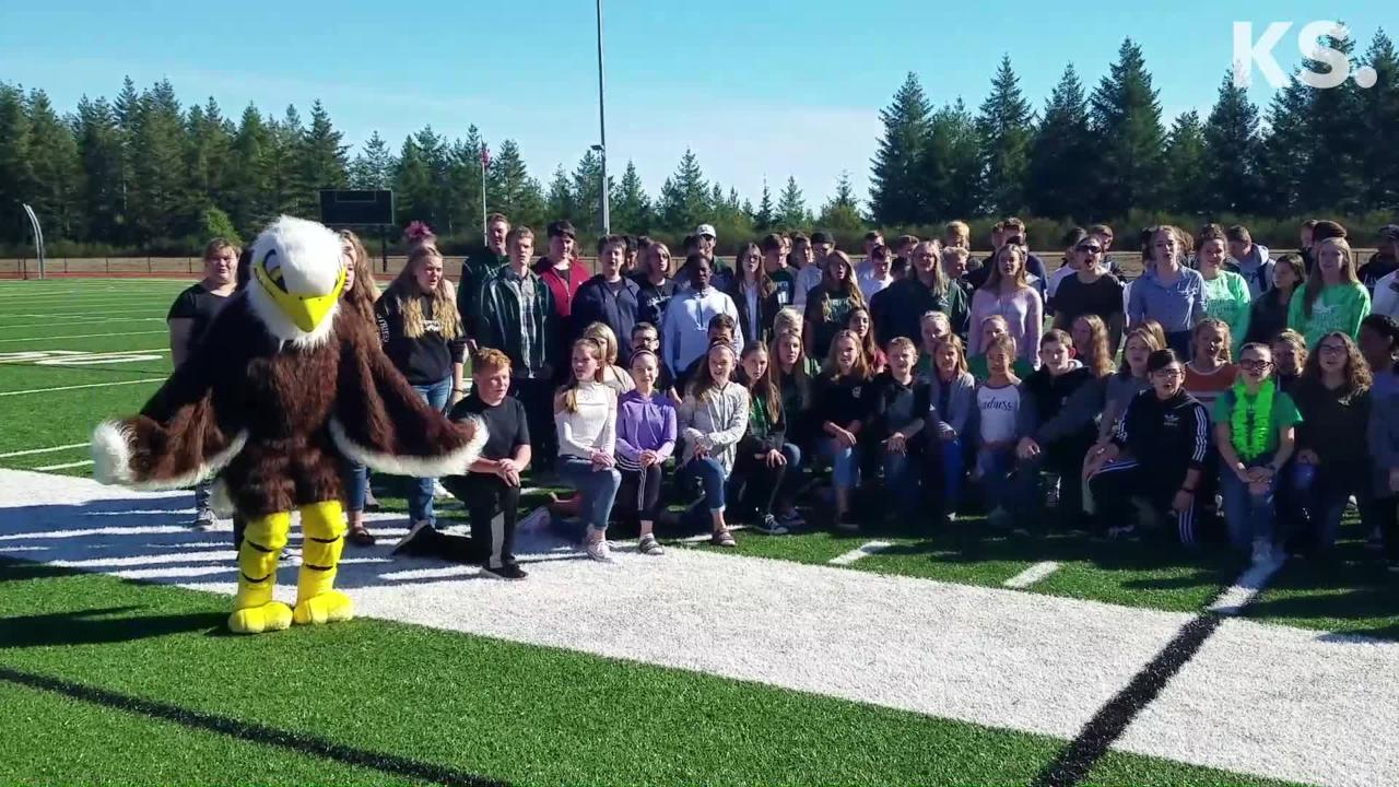 Klahowya football coach Dan Ericson wore an Eagle mascot costume as students performed the school's new fight song on Sept. 26, 2018.