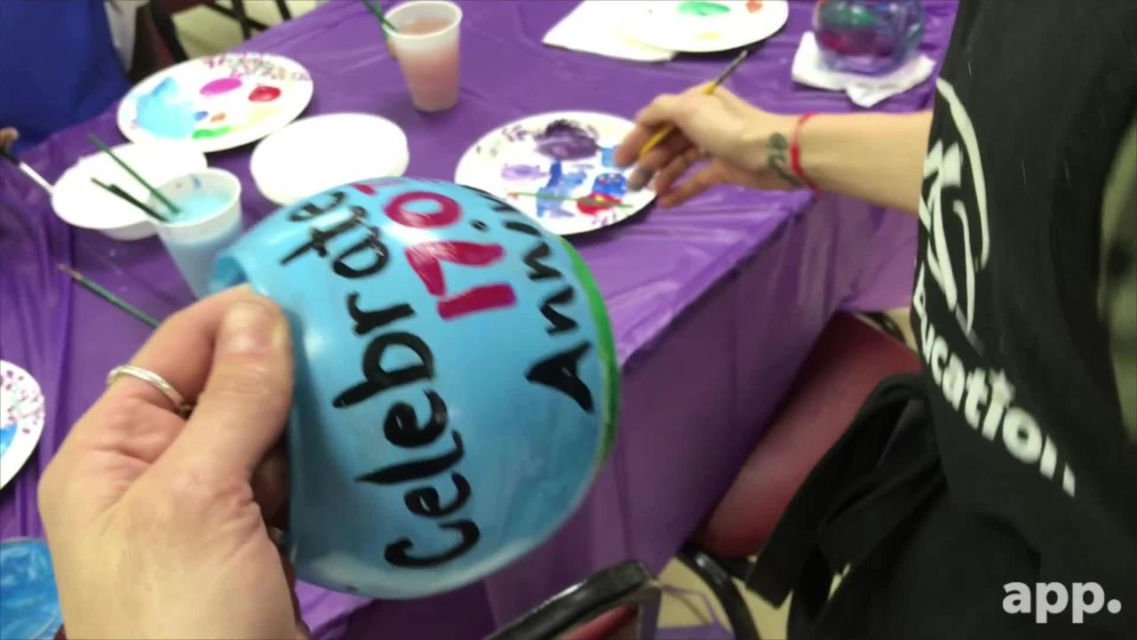 """Parishioners Sheryl Warrington and Kelly Guerra organized a """"Paint-N-Praise"""" event so children could celebrate the church's 170th anniversary."""