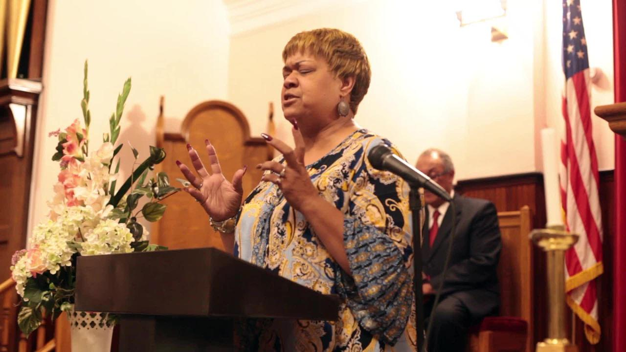 The Rev. Elaine Rose calls out to the congregation to bring prayers to Staunton City School's superintendent Dr. Garett Smith.
