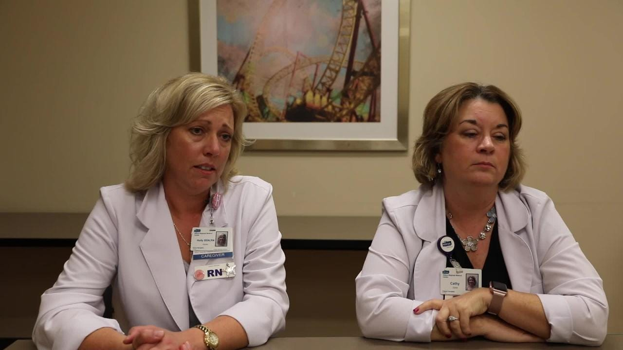 Holly Hooks, left, and Cathy Zeller discuss the role of what a nurse navigator does at Adena Cancer Center.