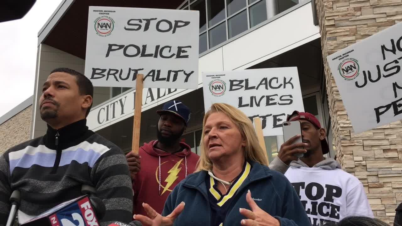 Protestors marched at Westland City Hall denouncing alleged mistreatment by city police officer.  They called for police body cameras.