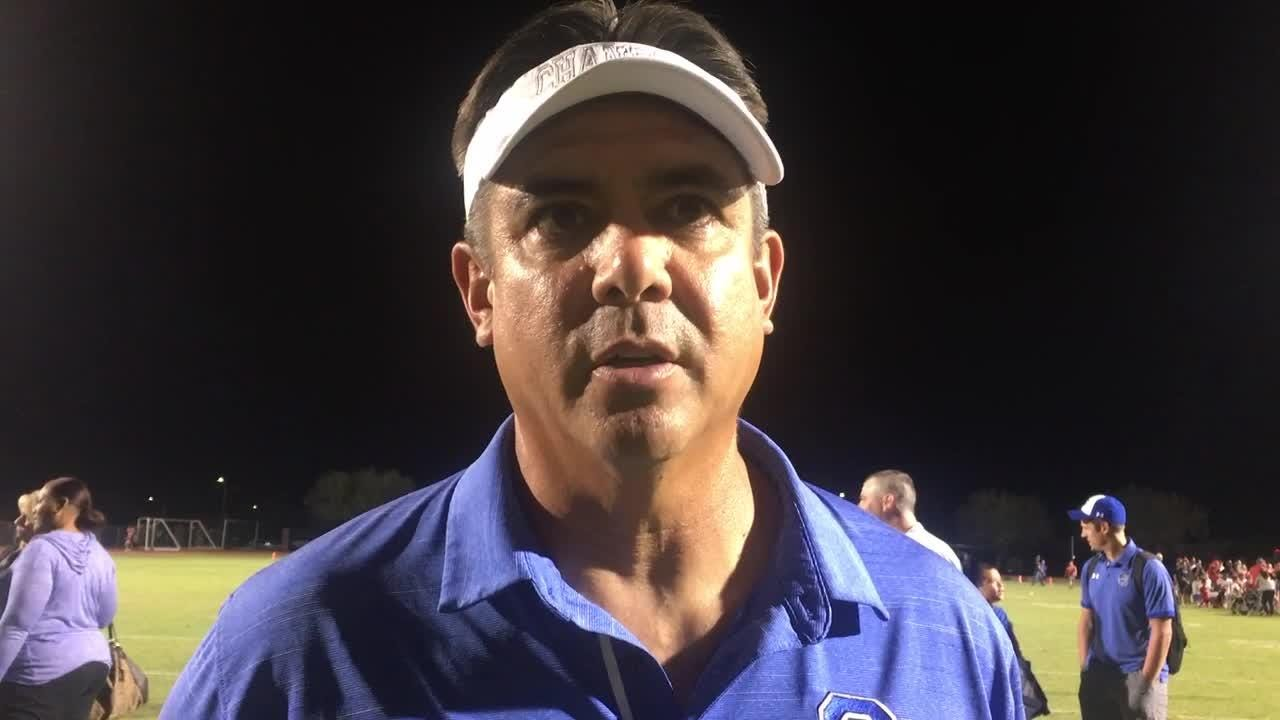Chandler coach Shaun Aguano reacts to team's win over Brophy