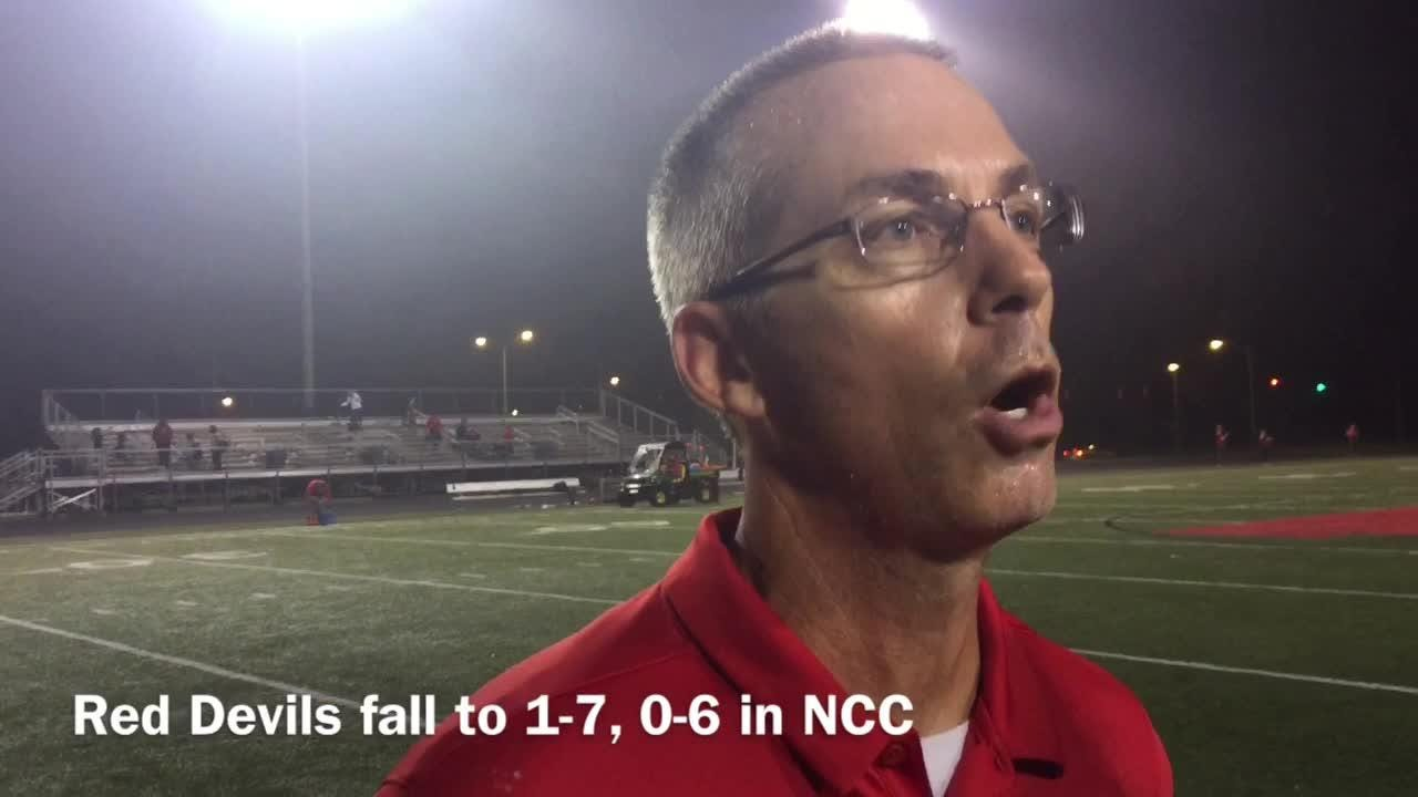Treshawn Jones pick and coach Lewis talk football