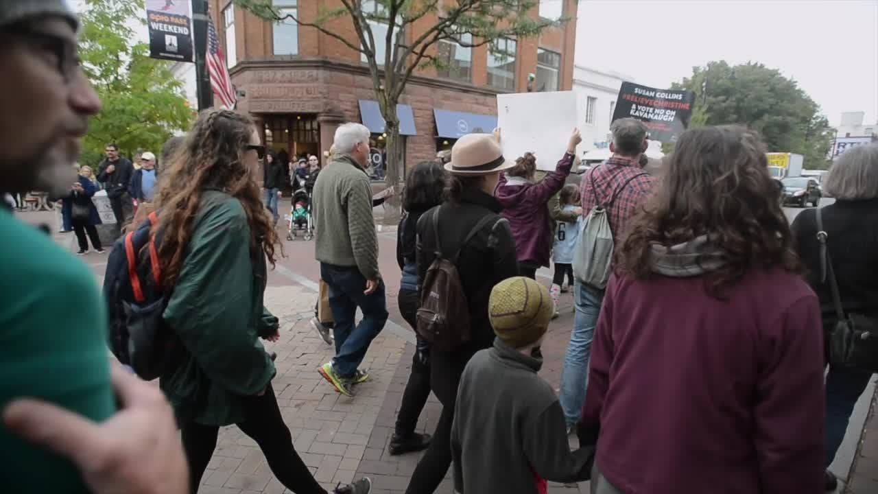 About 100 people, mostly women, protesting Supreme Court nominee Brett Kavanaugh marched though Burlington, VT, on Saturday, Oct. 6, 2018.