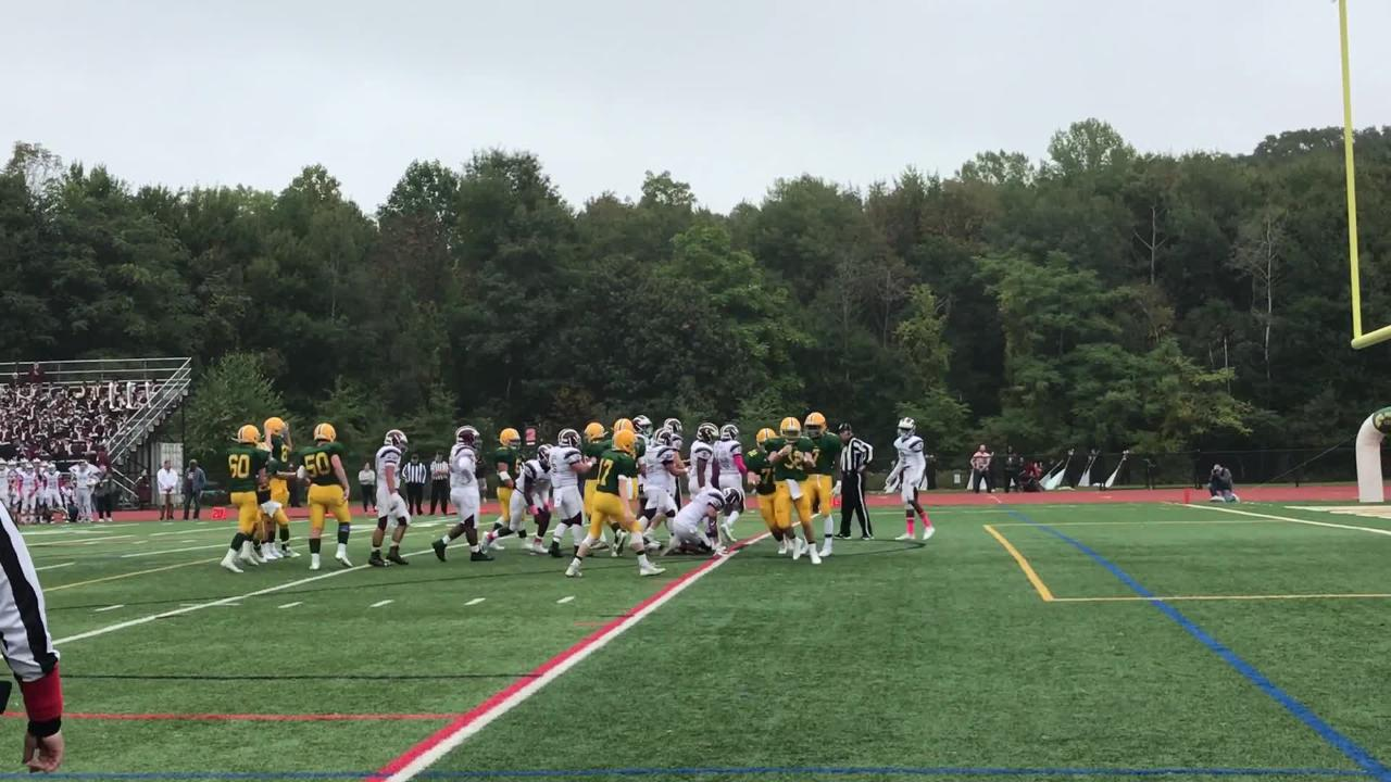 Morris Knolls RB Brydon Gibbs barrels in for an 8-yard touchdown run early in the second quarter to give the Golden Eagles a 7-0 lead over Morristown.
