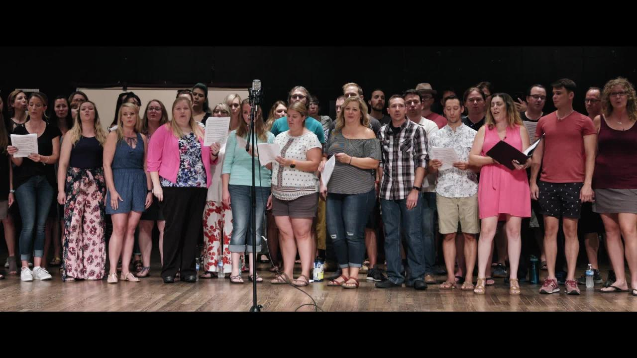 Rocky Mountain High School choir alums come together to sing for former teacher as she battles cancer.