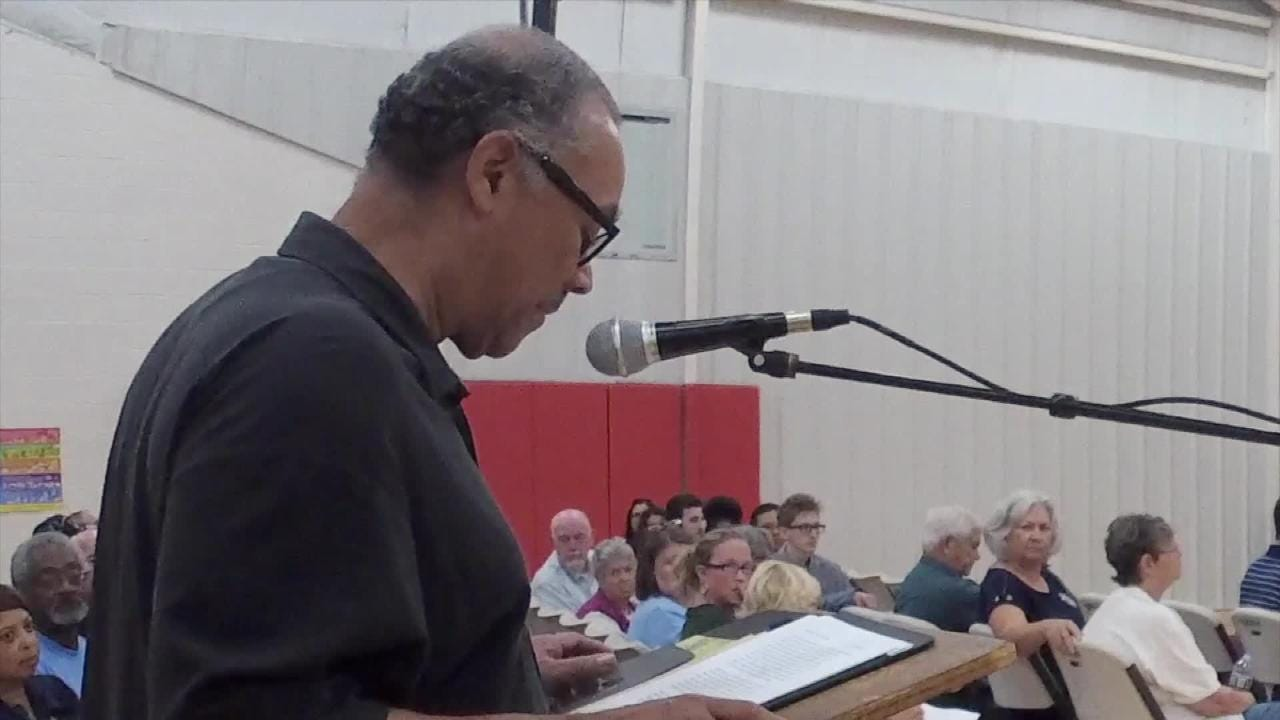 The Rev. Edward Scott delivers a closing argument before the school board voted 4-2 to strip the R.E. Lee from the high school.