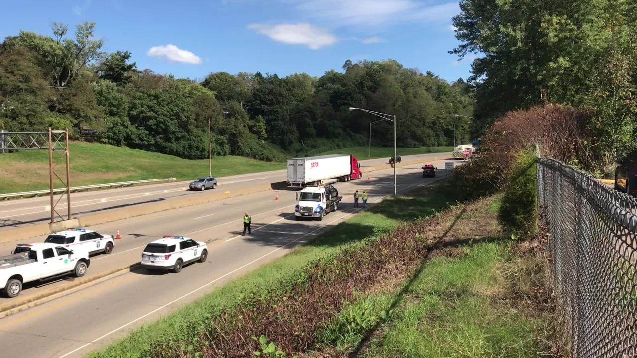 Emergency crews clear a three-vehicle wreck on I-70 Tuesday afternoon.